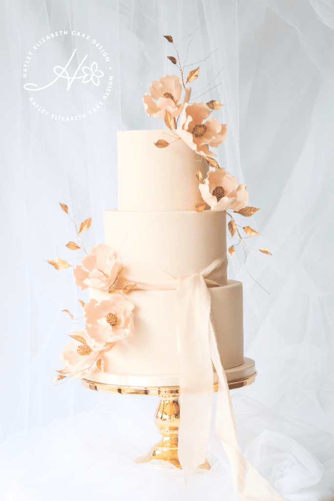 Luxury wedding cake from Hayley Elizabeth Cake Design, peach and gold wedding cake, wedding cake inspiration, elegant wedding cakes, Hampshire cake designer., blush and gold wedding cake, gold wedding cake, gold leaf wedding cake, ribbon wedding cake