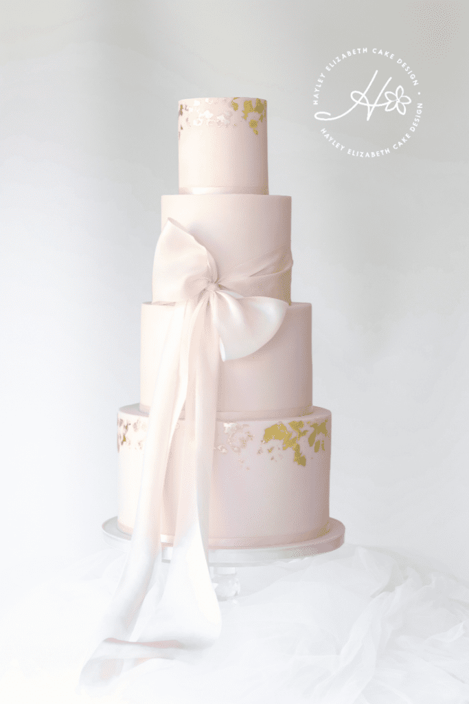 Pink wedding cake, bow wedding cake, pink and gold wedding cake, gold leaf wedding cake, blush wedding cake, blush and gold wedding cake, elegant wedding cakes, luxury wedding cake