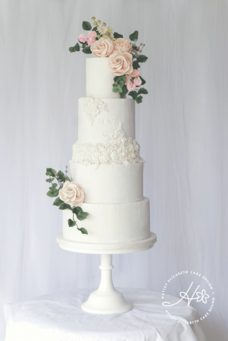 Textured wedding cake, textured white wedding cake with embossed initials and mouldings