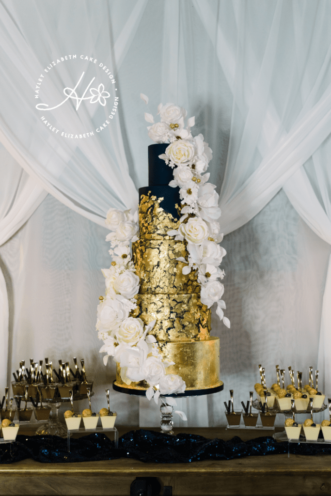 Gold leaf wedding cake, five tier wedding cake, white and gold wedding cake, elegant wedding cakes, luxury wedding cake, luxury dessert table, rustic luxe wedding theme