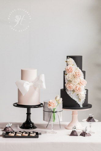 Luxury wedding cakes in blush and black | Trio of modern wedding cakes with silver leaf | Discover more luxury wedding cake designs | white blush wedding cake | wedding cake with bow | bow wedding cake | pink wedding cake ideas | sugar flower wedding cake | wedding cake with sugar flowers | black wedding cake | black blush wedding | modern wedding cake | elegant wedding cake display | luxury wedding cake unique | luxury wedding cake table #modernweddingcake #weddingcakeideas #blackweddingcake