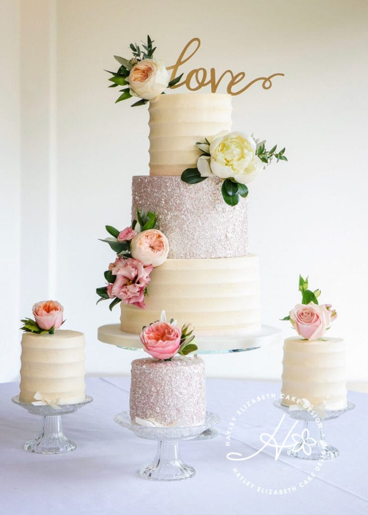 Luxury wedding cake by Hayley Elizabeth cake design, Hampshire and Dorset. Elegant wedding cake, shimmer wedding cake, sequin wedding cake, fondant icing, fresh flowers, elegant wedding cake, wedding cake inspiration