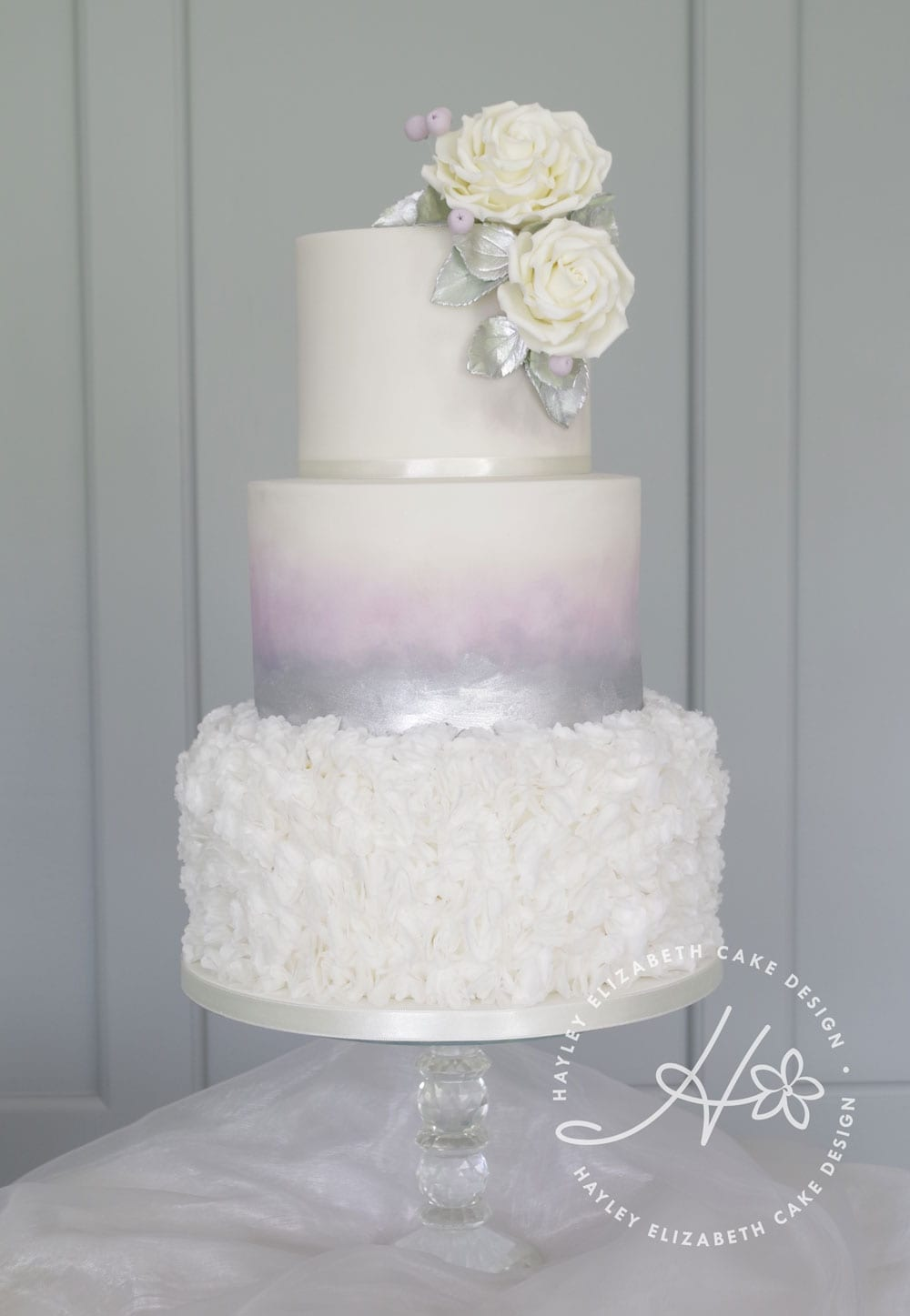 Luxury white and silver wedding cake with watercolour and silver shimmer. Sugar flowers, ruffles, silver foliage. Elegant wedding cake, wedding cake inspiration, ombre wedding cake, Hampshire and Dorset cake design
