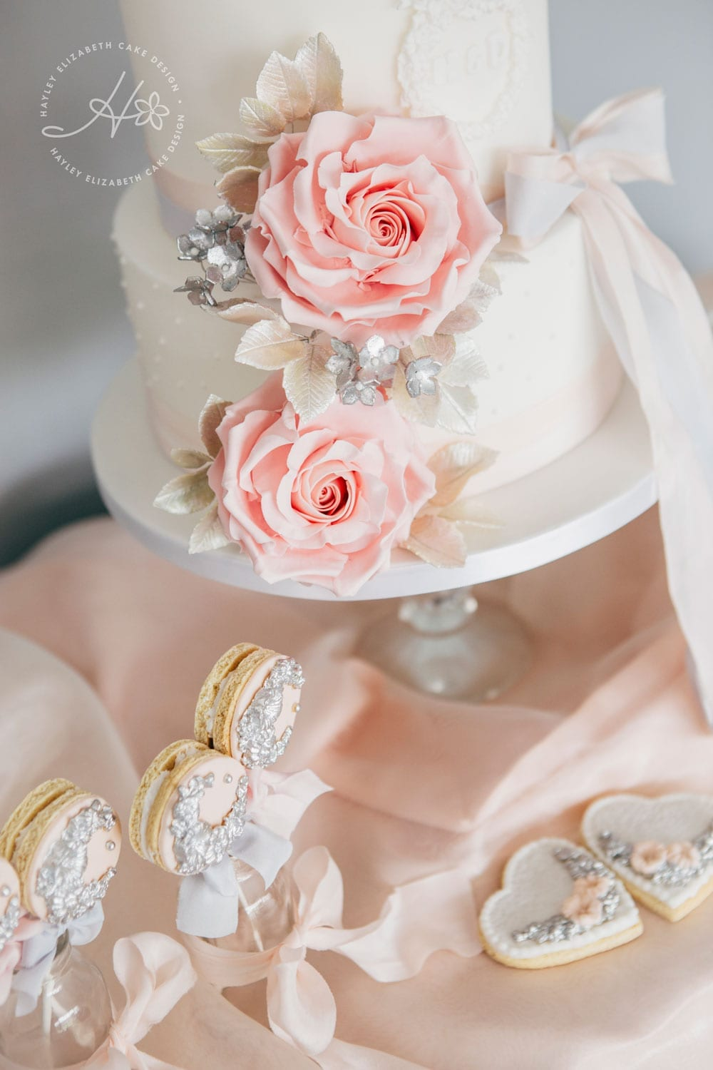 Pink grey and silver dessert table, luxury wedding cake, cake pops, iced biscuits, mini cakes, dessert bar, white wedding cake, sugar flowers, wedding cake inspiration