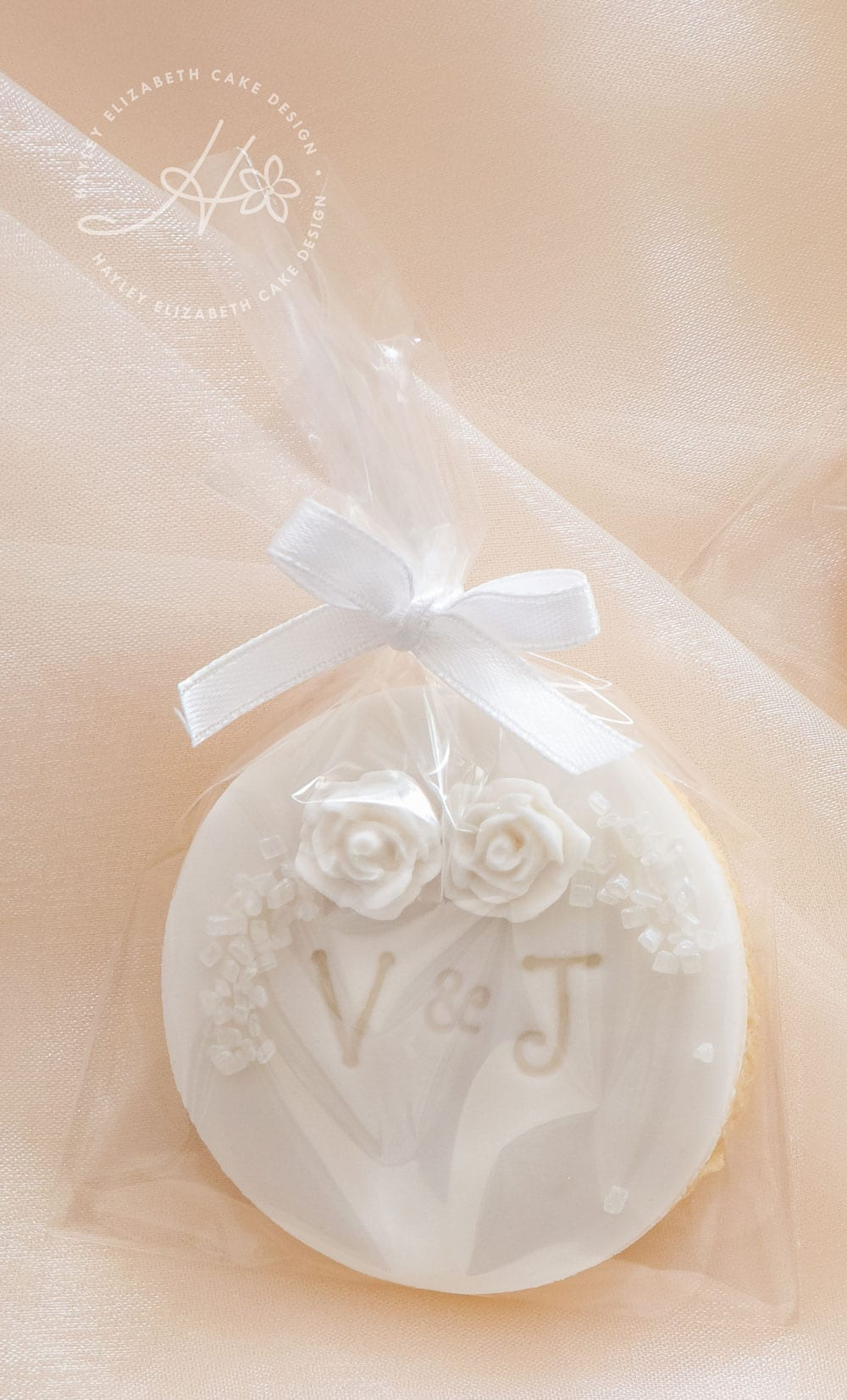 Gold and white dessert table, wedding favours, edible wedding favours, luxury wedding cake, cake pops, iced biscuits, mini cakes, silver and white wedding cake, dessert bar, white sequin wedding cake, sugar flowers, wedding cake inspiration