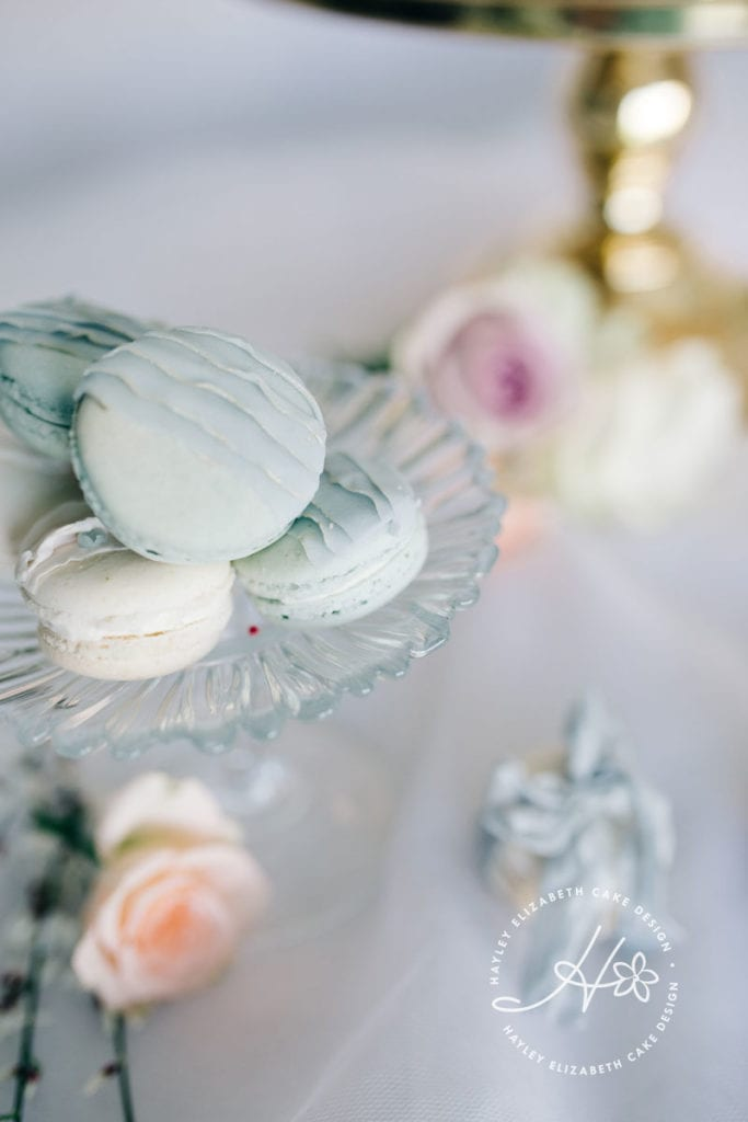 Blue macarons, pastel blue macarons, blue and gold cakes, pretty macarons, dessert table, wedding favours, edible wedding favours, pretty sweet treats, wedding sweet table, wedding cake table, pretty desserts, christening favours, luxury party favours, boy baby shower