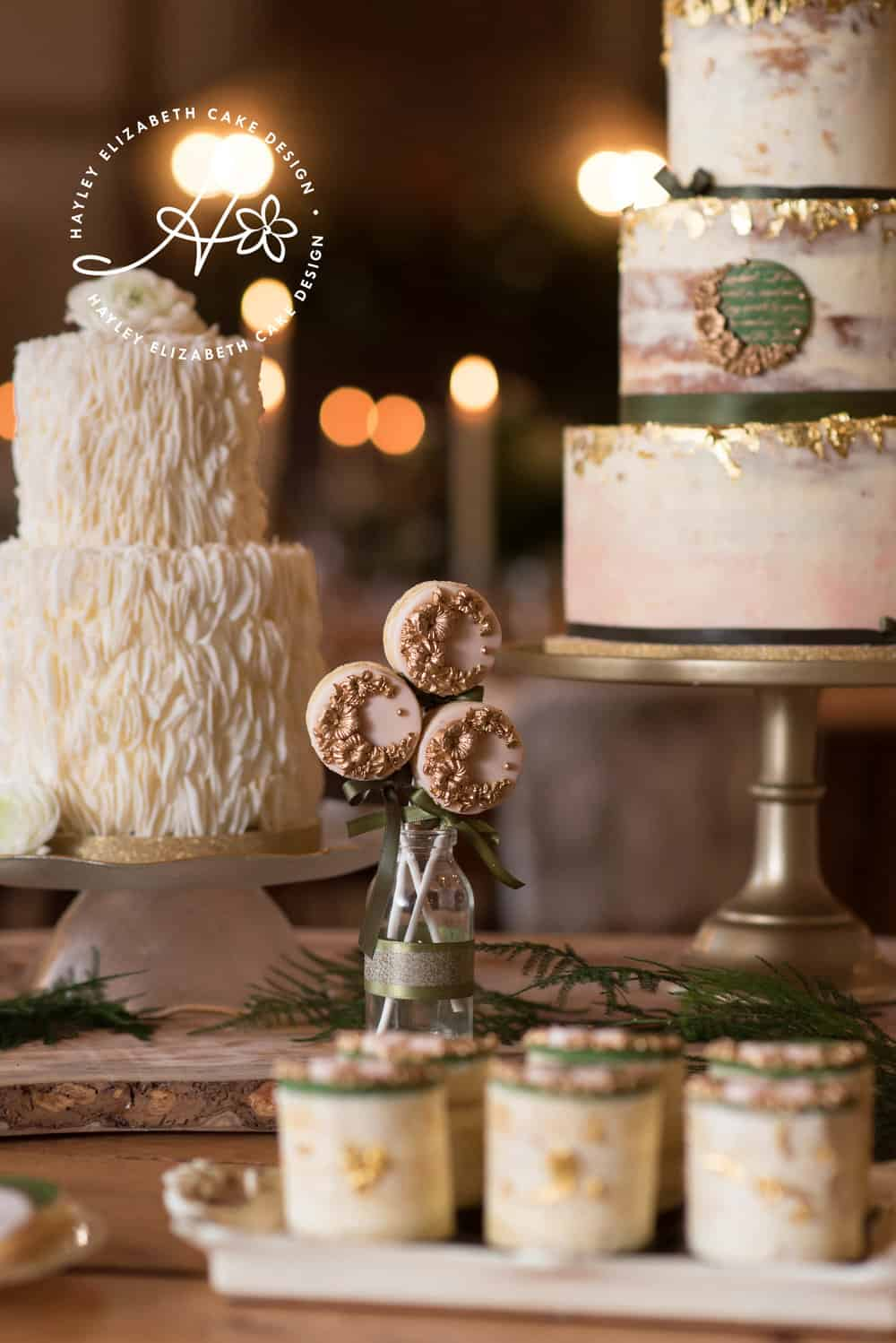 Christmas dessert table, luxury wedding cake, cake pops, iced biscuits, mini cakes, silver and white wedding cake, dessert bar, sugar flowers, wedding cake inspiration