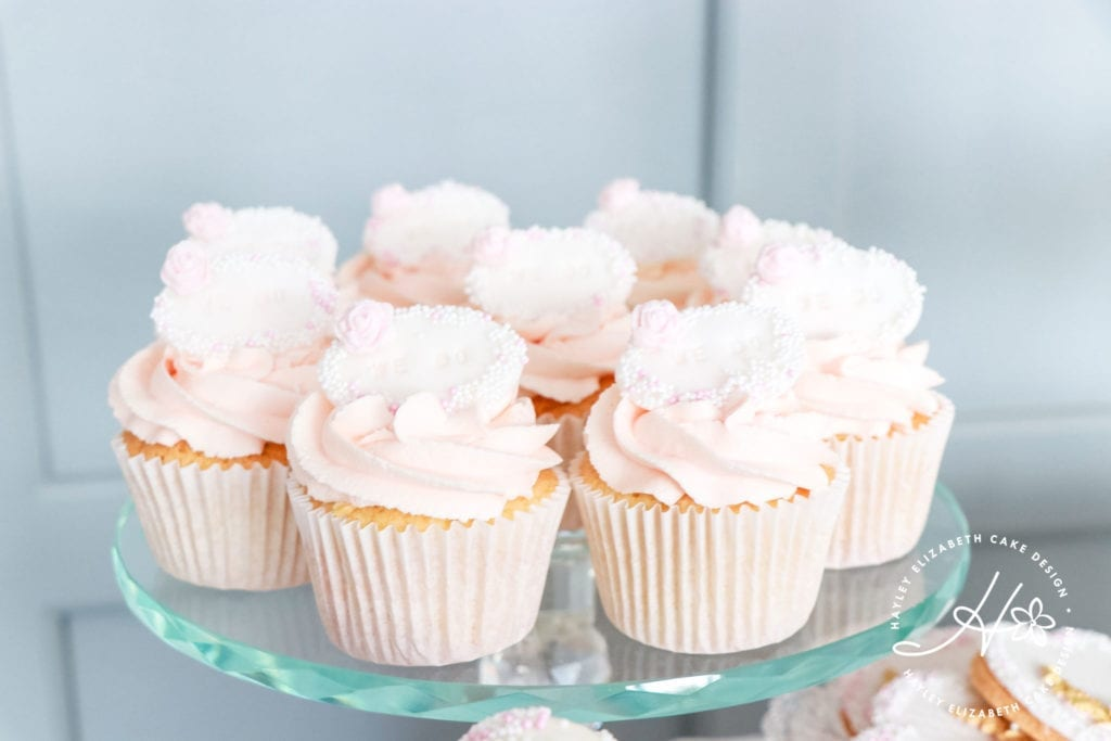 Pink cupcakes, luxury dessert table, white, gold and pink wedding cake, elegant wedding cakes, sugar flowers, Hampshire and Dorset cake designer, wedding cake inspiration, luxury wedding cakes, hampshire wedding venues, dorset wedding venues, wedding cake ideas, wedding cake inspiration