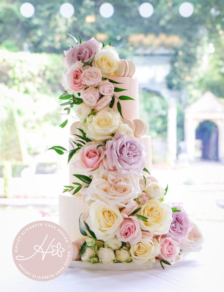 Luxury white wedding cake with macarons and fresh flowers. Spring wedding cake, summer wedding cake, elegant wedding cake, wedding cake inspiration, Hampshire and Dorset cake design