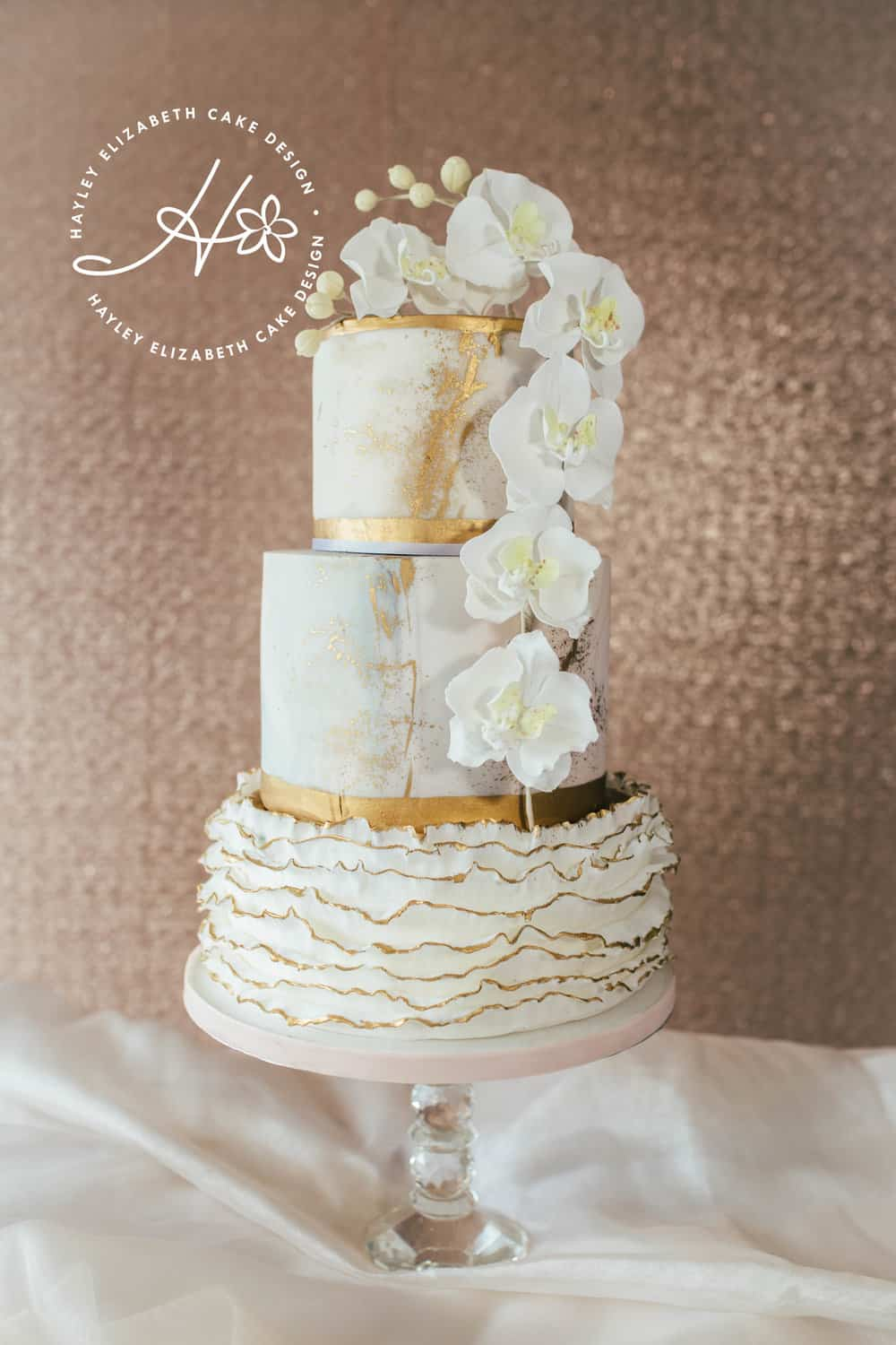 Luxury Wedding Cake With Gold Foil Marble Effect Icing Sugar Flower Orchids And Ruffles