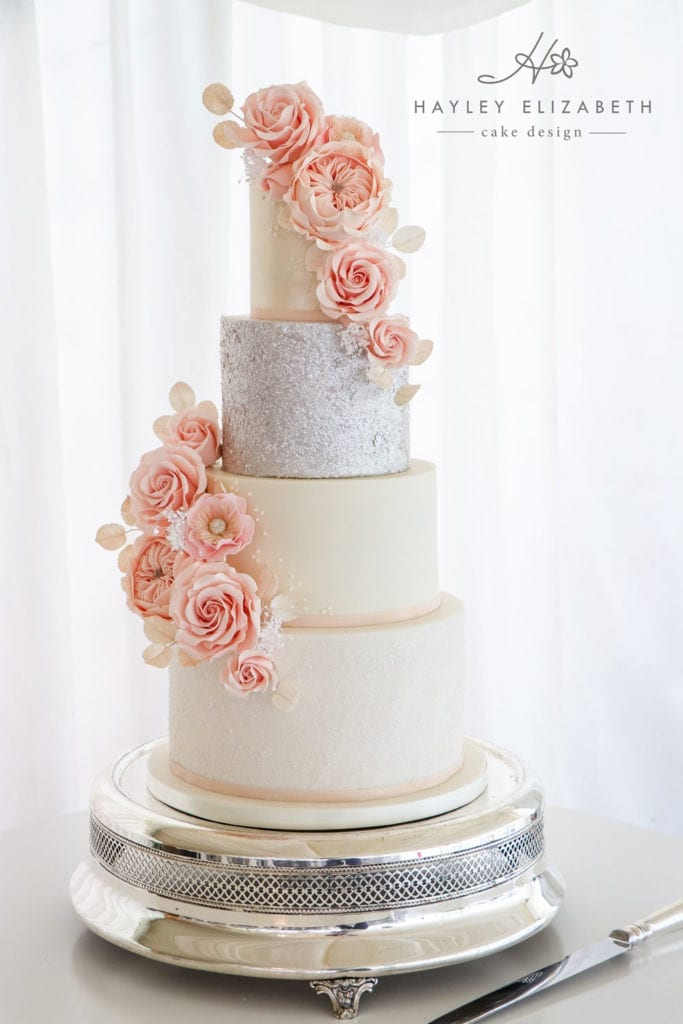 Luxury wedding cake from Hayley Elizabeth Cake Design, Dorset and Hampshire cake designer. White and blush wedding cake, silver sequin wedding cake, sugar flowers, white silver pink wedding cake, white wedding cake, elegant wedding cake, wedding cake ideas.