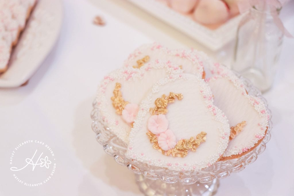 Iced heart biscuits, luxury dessert table, white, gold and pink wedding cake, elegant wedding cakes, sugar flowers, Hampshire and Dorset cake designer, wedding cake inspiration, luxury wedding cakes, hampshire wedding venues, dorset wedding venues, wedding cake ideas, wedding cake inspiration