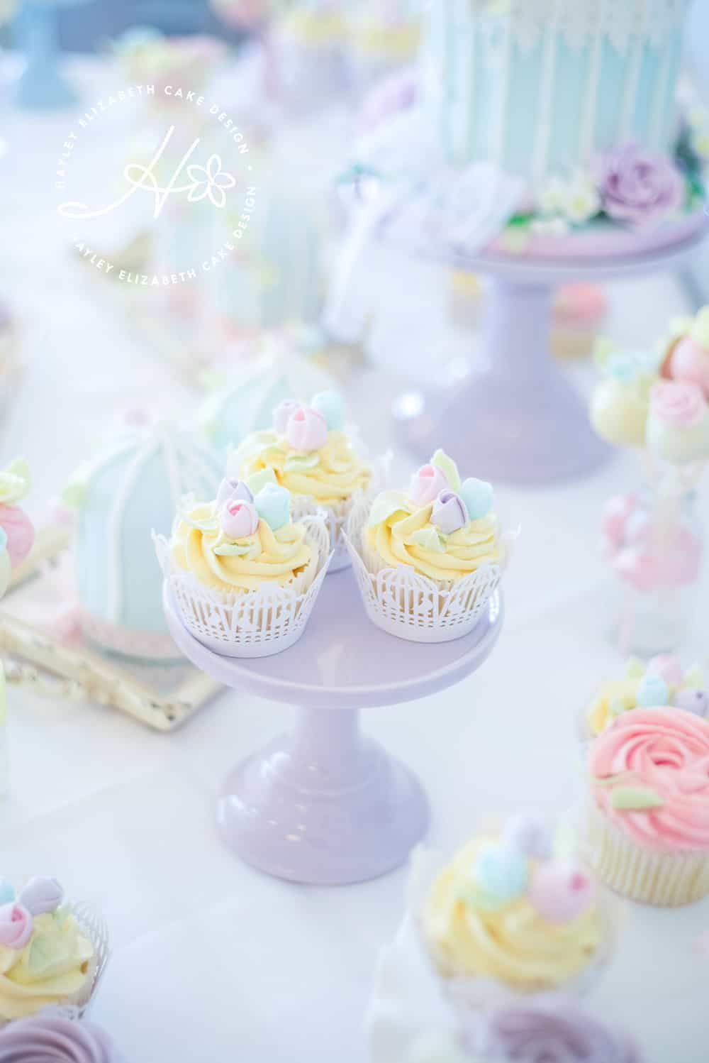 Pastel cupcakes, pastel sugar flowers, luxury wedding cake, cupcakes, cake pops, iced biscuits, mini cakes, dessert table, white wedding cake, wedding cake inspiration