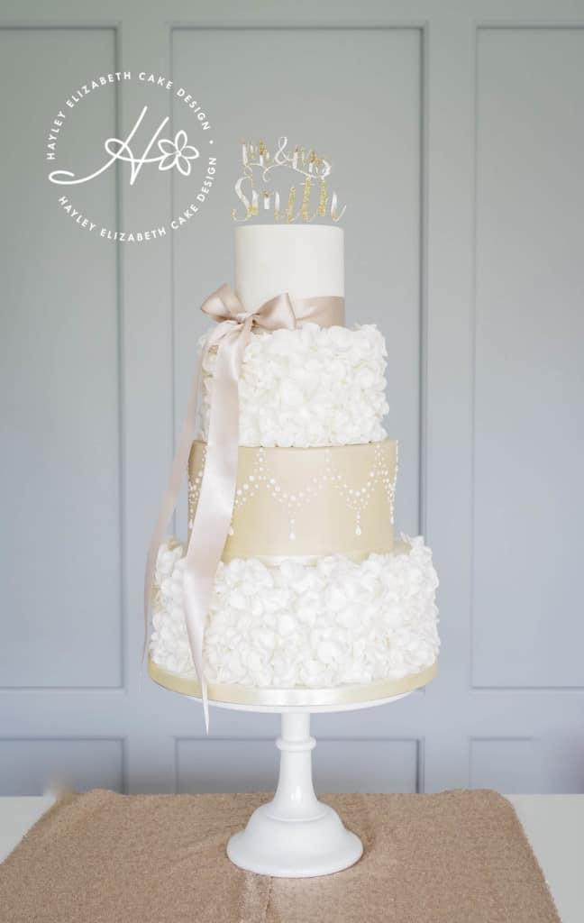 Ruffle and gold shimmer wedding cake. Luxury wedding cake, elegant wedding cake, ivory wedding cake, wedding cake inspiration, Hampshire and Dorset cake design.