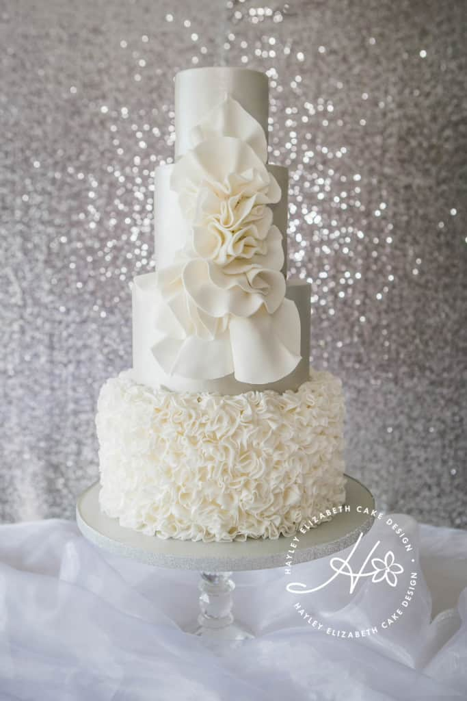 Silver shimmer wedding cake from Hayley Elizabeth, Hampshire and Dorset cake design. White wedding cake, ruffle wedding cake, luxury wedding cake, elegant wedding cake, wedding cake inspiration
