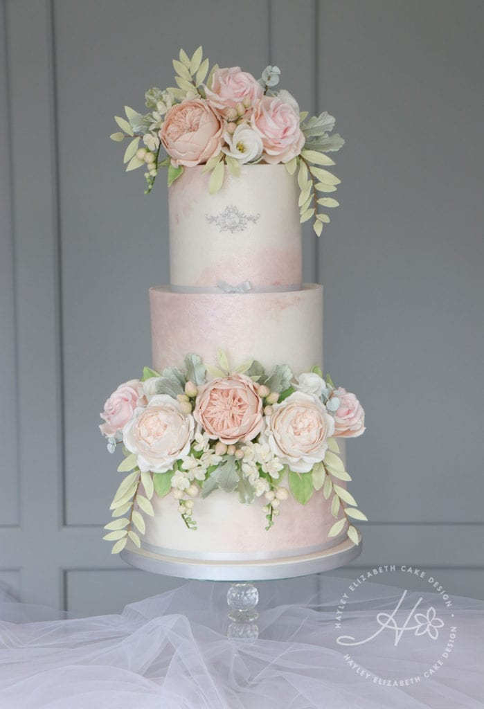 Luxury wedding cake from Hayley Elizabeth Cake Design, UK cake designer. Blush wedding cake, silver wedding cake, neutral sugar flowers, sugar foliage wedding cake, white wedding cake, elegant wedding cake, wedding cake ideas, painted wedding cake.