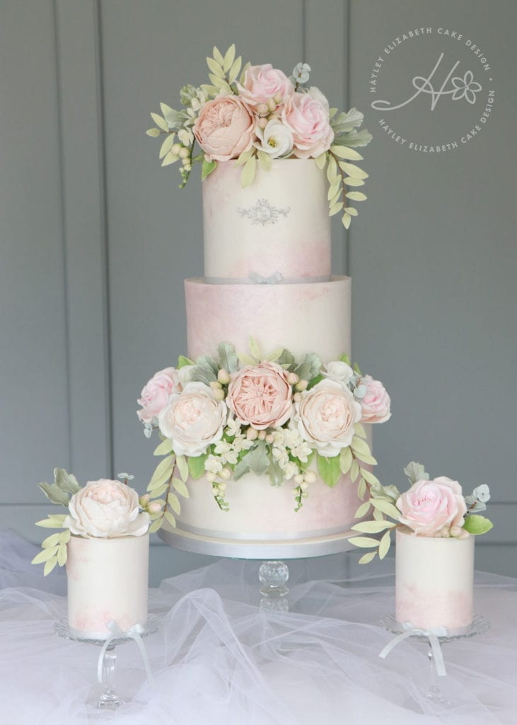 Luxury wedding cake from Hayley Elizabeth Cake Design, UK cake designer. Blush wedding cake, neutral sugar flowers, mini cakes, luxury dessert table, wedding cake, white wedding cake, elegant wedding cake, wedding cake ideas, painted wedding cake.