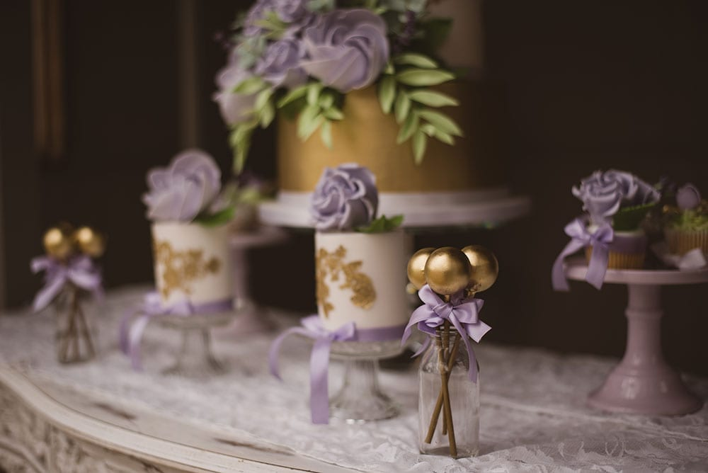 Gold and purple dessert table, luxury wedding cake, cupcakes, cake pops, iced biscuits, mini cakes, dessert bar, elegant wedding cake, sugar flowers, wedding cake inspiration