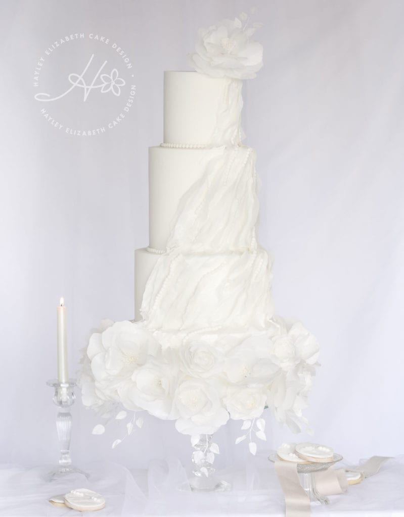 All white wedding cake, ruffle wedding cake, luxury wedding cake, elegant wedding cakes, fine art wedding cake, wedding cake inspiration, white shimmer wedding cake, winter wedding cakes, white dessert table, luxury dessert table, bridal shower cake