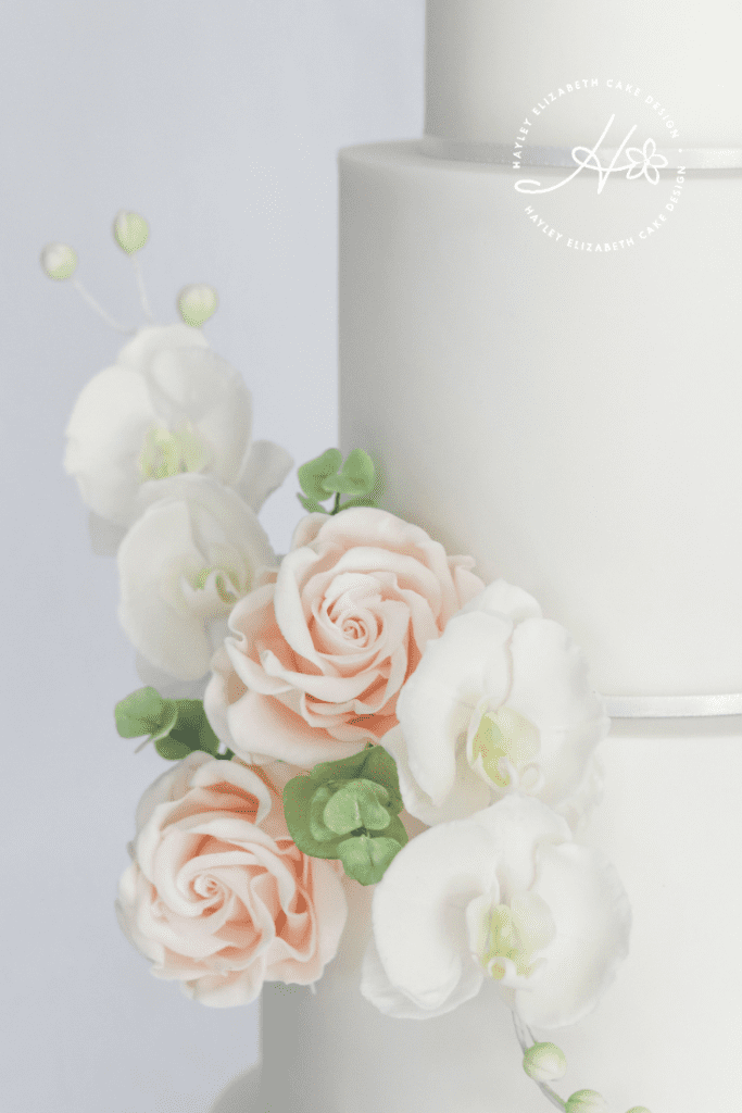 White wedding cake with sugar orchids and sugar roses, neutral wedding cake, luxury wedding cake, simple wedding cake, elegant wedding cakes, timeless wedding cake