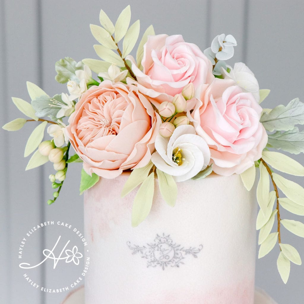 Luxury wedding cake from Hayley Elizabeth Cake Design, UK cake designer. Blush wedding cake, neutral sugar flowers, luxury dessert table, white wedding cake, elegant wedding cake, wedding cake ideas, painted wedding cake.