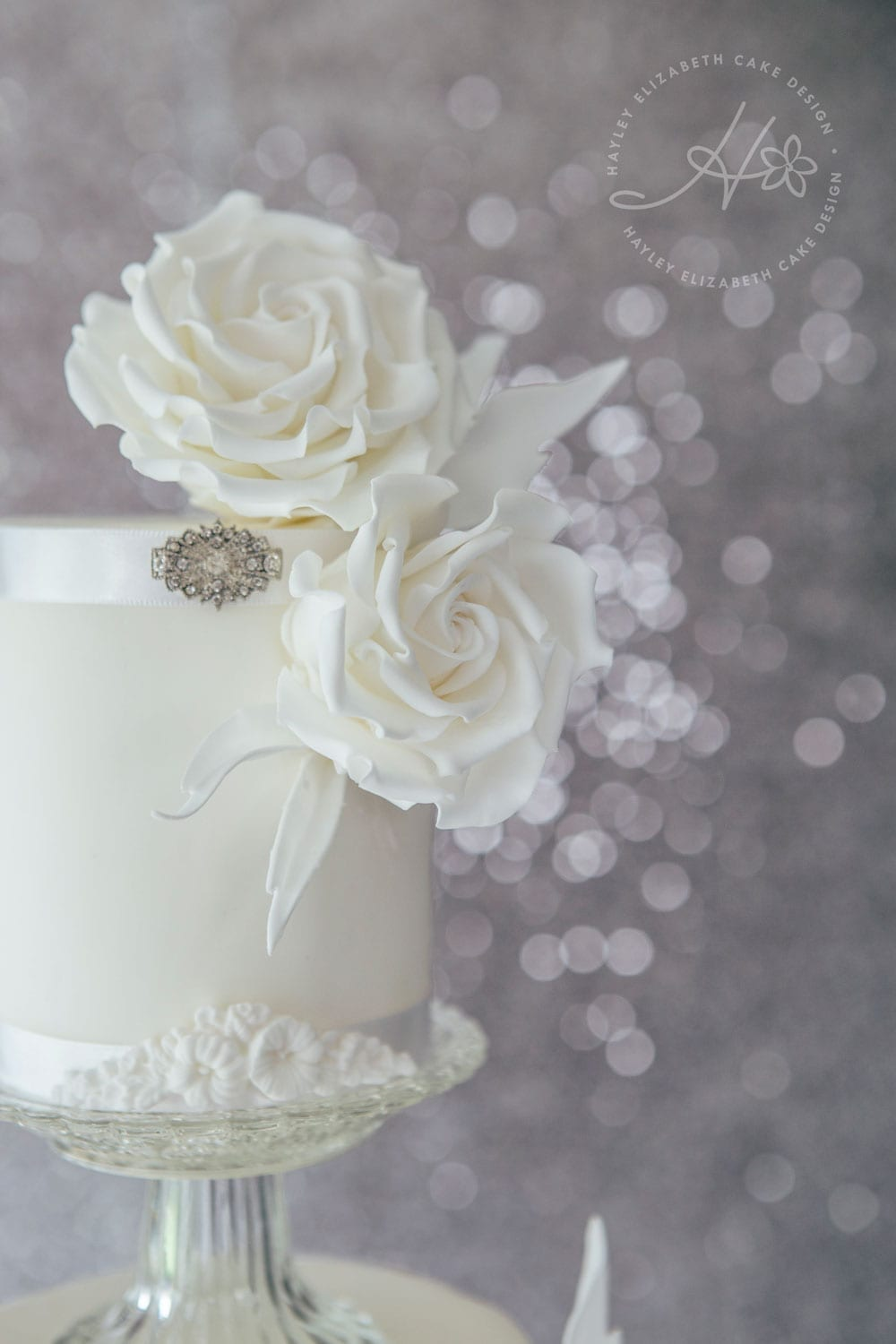 All white wedding cake, luxury wedding cake, elegant wedding cake, Hayley Elizabeth Cake Design, Dorset & Hampshire wedding cakes, sugar flowers, sugar roses, white on white wedding cake, wedding cake inspiration, wedding cake ideas