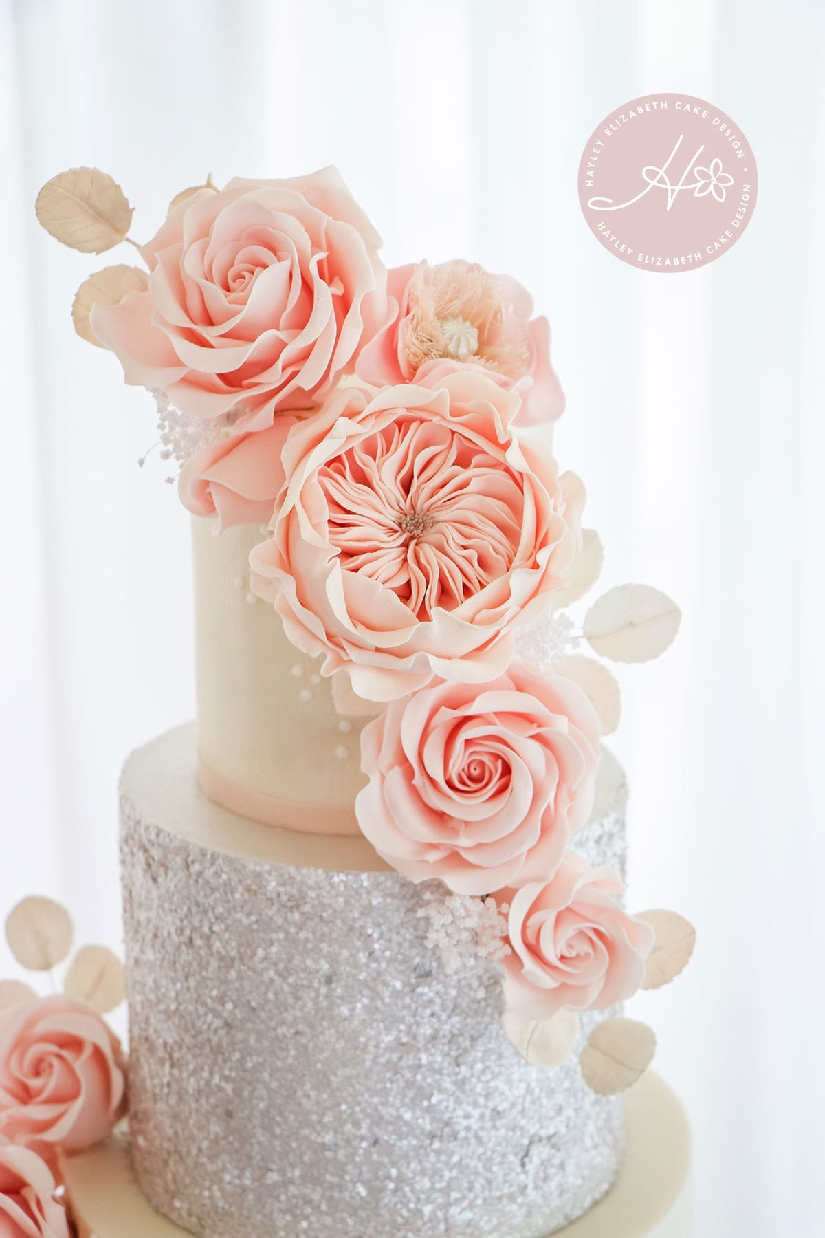 Blush sugar flowers, luxury wedding cake from Hayley Elizabeth Cake Design, Dorset and Hampshire cake designer. White and blush wedding cake, silver sequin wedding cake, sugar flowers, white silver pink wedding cake, white wedding cake, elegant wedding cake, wedding cake ideas.