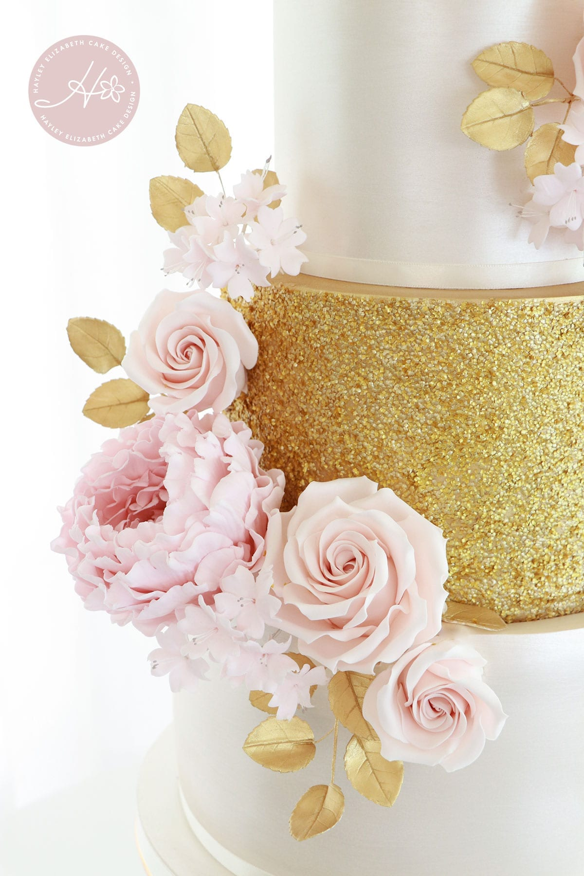 Luxury wedding cake from Hayley Elizabeth Cake Design, Dorset and Hampshire cake designer. Gold and blush wedding cake, gold sequin wedding cake, sugar flowers, white gold pink wedding cake, white and gold wedding cake, elegant wedding cake, wedding cake ideas.