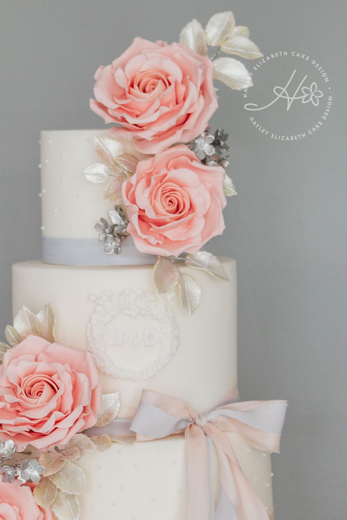 Luxury wedding cake from Hayley Elizabeth Cake Design, sugar roses, silver leaf foliage, fondant icing, elegant wedding cake, pretty wedding cake, pink and grey wedding cake, silver wedding cake, wedding cake inspiration