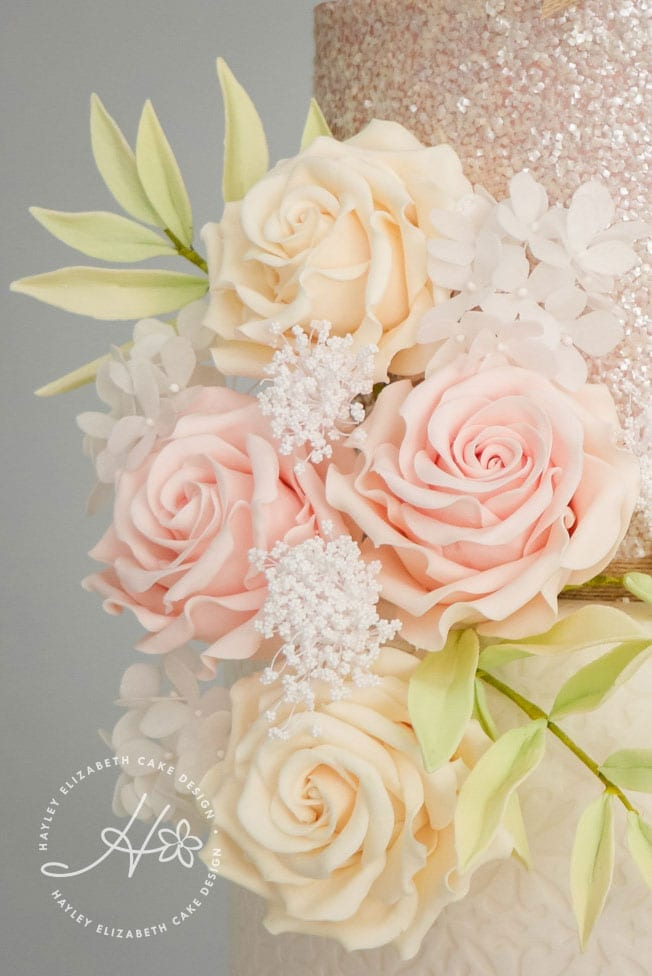 Neutral sugar flowers, luxury wedding cake from Hayley Elizabeth Cake Design, Dorset and Hampshire cake designer. Peach wedding cake, sequin wedding cake, sugar flowers, white silver pink wedding cake, white wedding cake, elegant wedding cake, wedding cake ideas.