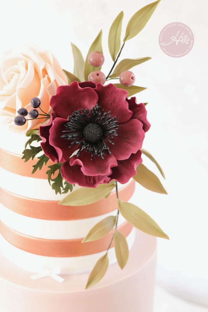 Burgundy sugar flowers, luxury wedding cake from Hayley Elizabeth Cake Design, Dorset and Hampshire cake designer. Rose gold wedding cake, copper wedding cake, sugar flowers, autumnal wedding cake, white wedding cake, elegant wedding cake, wedding cake ideas.