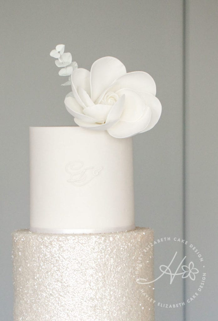 All white wedding cake from Hayley Elizabeth, Cake Designer . White wedding cake, ruffle wedding cake, luxury wedding cakes, elegant wedding cakes, wedding cake inspiration, white shimmer wedding cake, sequin wedding cake, winter wedding cake