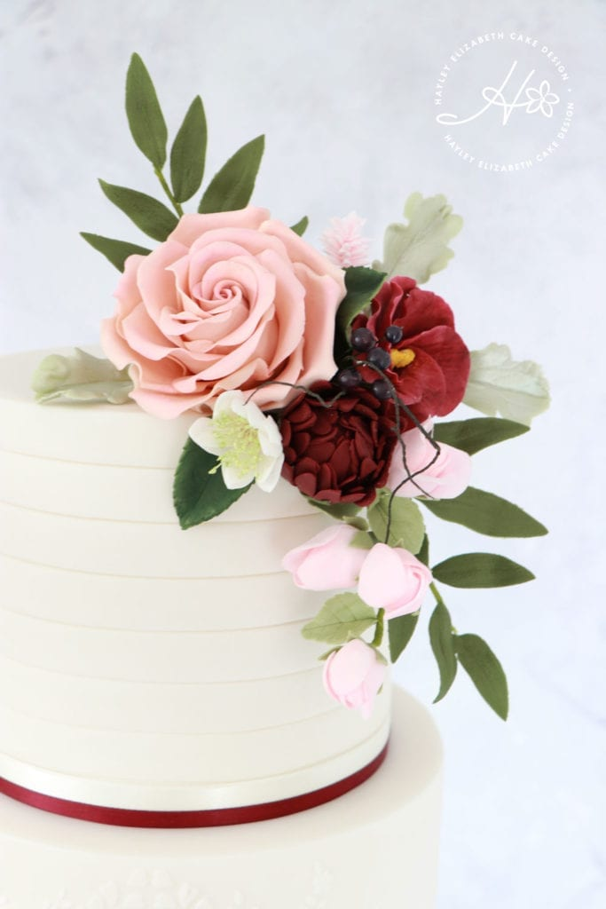 Burgundy sugar flowers, luxury wedding cake from Hayley Elizabeth Cake Design, Dorset and Hampshire cake designer. Autumn wedding cake, elegant wedding cake, autumnal sugar flowers, autumn wedding,  wedding cake ideas.