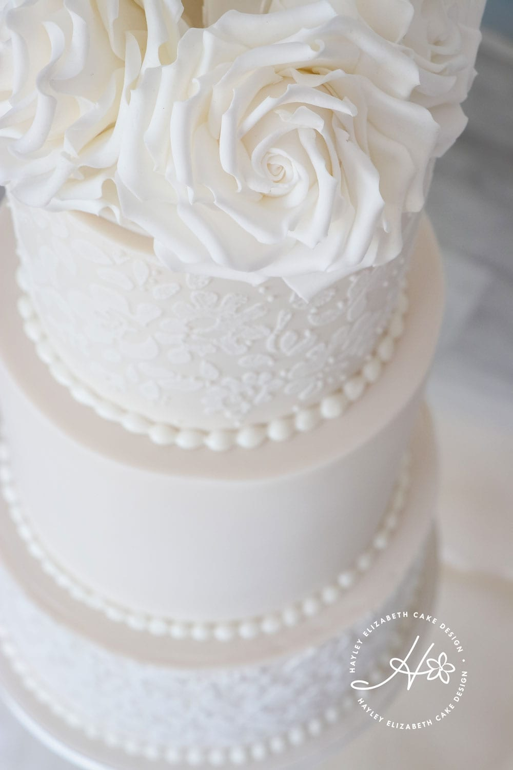 All white wedding cake from Hayley Elizabeth Cake Design, luxury wedding cake, elegant wedding cake, sugar flowers, wedding cake inspiration, Hampshire wedding cake design, cake art, Dorset cake design, wedding planning